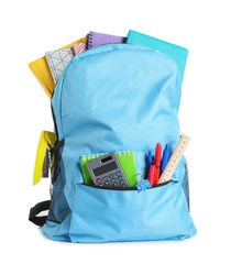 Backpack with school stationery on white background