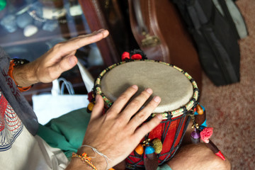 Hands of man playing African drum or djembe. Chiang Mai, Thailand.