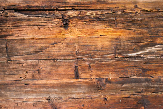 horizontal wooden planks of an old Swiss mountain hut darkened by the sun and winter weather of the Alps, Switzerland
