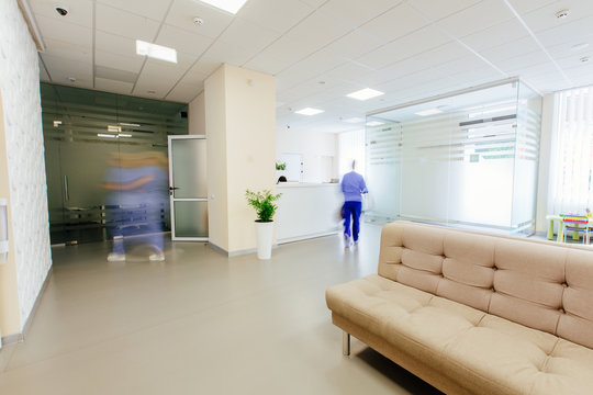 Empty white hall in the modern office gynecologycal clinic building. Motion blur