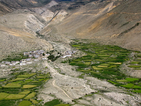 Panoramic view of a small tibetan village in a valley surrounded by mountains, somewhere along the way from Rongbuk monastery to Zhangmu near the nepalese border, Tibet