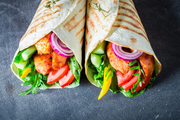 Closeup of delicious grilled tortilla with chicken, tomatoes and lettuce