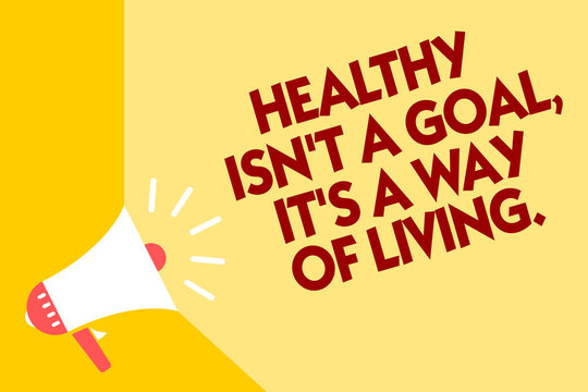 Text sign showing Healthy Isn t not A Goal, It s is A Way Of Living.. Conceptual photo Create good habits routines Megaphone loudspeaker yellow background important message speaking loud.