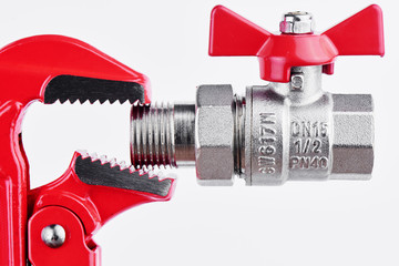 Red gas key and valve for sanitary equipment on the white background. Plumbing concept..