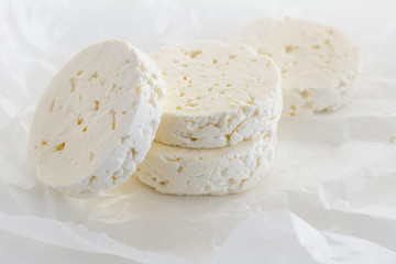 Feta cheese rounds on parchment paper