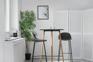 Stylish dining room interior. Home design idea