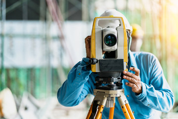 engineer site survey with laser tripod machine in site construction background Wall mural