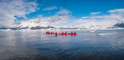 Wonderful view of Glacier Lagoon, Jokulsarlon, on South Iceland and people kayaking in red kayaks