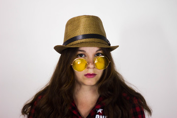Girl in hat and yellow sunglasses