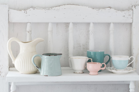 dinnerware on white wooden shelf