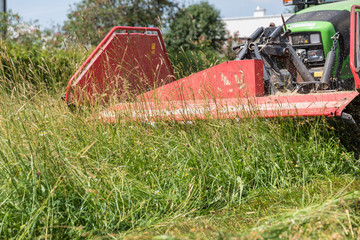 Mow grass with tractor and mower