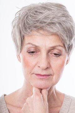 beautiful mature woman is thinking
