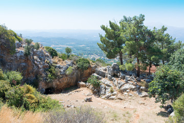entrance to Melidoni cave at the foot of the mountain on the island of Crete