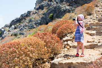 child takes pictures of nature on the island of Gramvousa