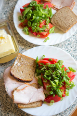 Tomatoes, scallions & basil salad with ham sandwiches and cheese