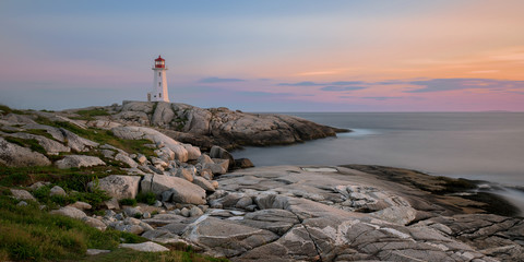 Wall Mural - Peggy's Point Lighthouse at sunset at Peggy's Cove in Nova Scotia