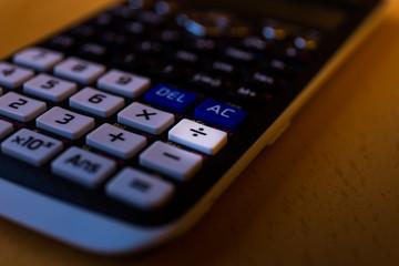 Dividing key of a scientific calculator keyboard