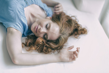 young redheaded woman wakes up