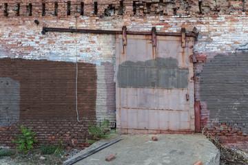 Metal industrial door on rail
