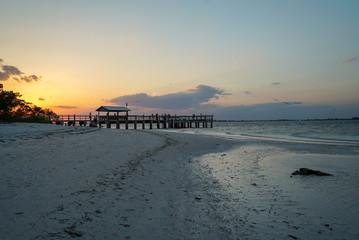 Brilliant Sunset at Sanibel Pier along sandy beach on Sanibel Island in Florida