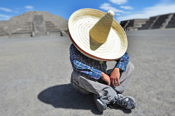 Man wearing Sombrero hat having a siesta/nap in Mexico
