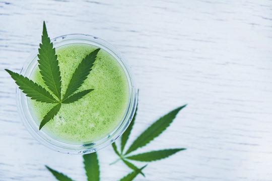 Green marijuana smoothie juice on white background.