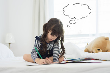 little girl draws paints the picture on paper and Ideas Icon