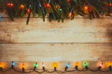 Wall Mural - Vintage Christmas lights bulb decoration on old wood plank. Merry Christmas and New Year holiday background. vintage color tone.