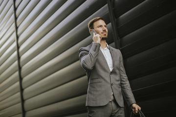 Stylish businessman walking outdoors