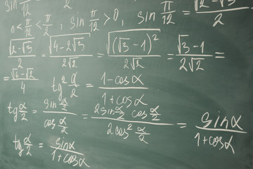 Algebra, mathematics. Trigonometry and elementary functions written on the chalkboard.