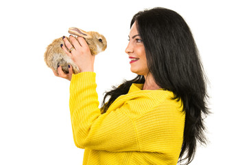 Profile of woman speaking with small bunny