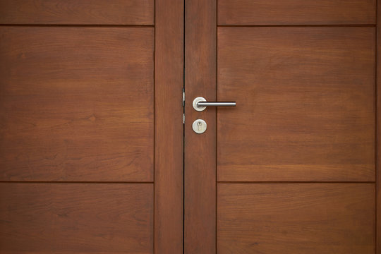 old wood door close with silver handle