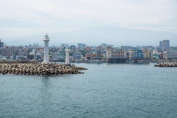 Jeju-si main city ocean view with white lighthouse, Jeju-si, Jeju Island, South Korea