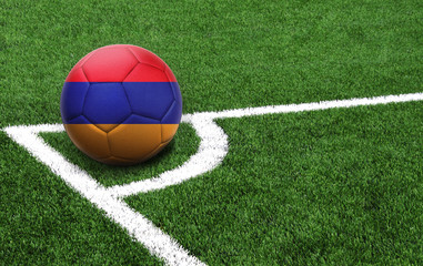 soccer ball on a green field, flag of Armenia