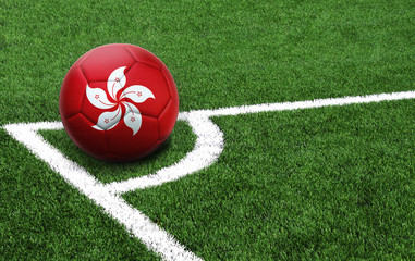 soccer ball on a green field, flag of Hong Kong