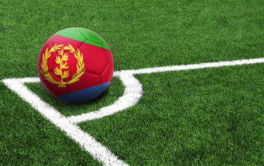 soccer ball on a green field, flag of Eritrea