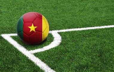 soccer ball on a green field, flag of Cameroon