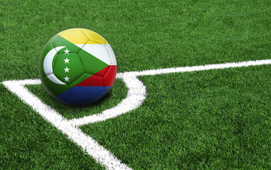 soccer ball on a green field, flag of Comoros