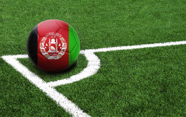 soccer ball on a green field, flag of Afghanistan