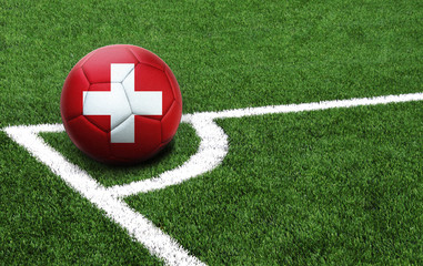 soccer ball on a green field, flag of Switzerland