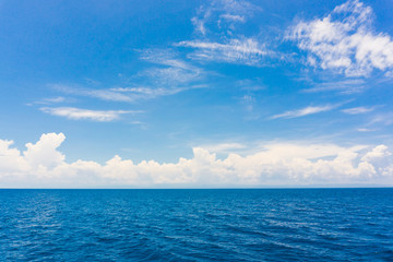 Blue sky with cloud in sea background