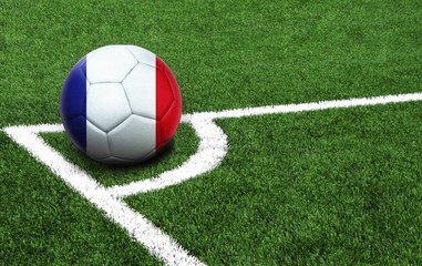 soccer ball on a green field, flag of France