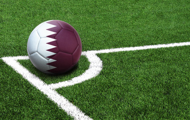 soccer ball on a green field, flag of Qatar
