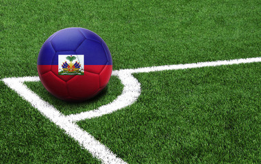 soccer ball on a green field, flag of Haiti