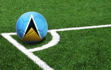 soccer ball on a green field, flag of Saint Lucia
