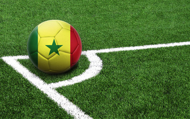 soccer ball on a green field, flag of Senegal