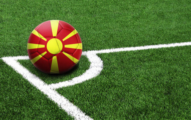 soccer ball on a green field, flag of Macedonia