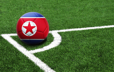 soccer ball on a green field, flag of North Korea
