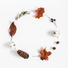 Autumn composition. Wreath made of eucalyptus branches, cotton flowers, dried leaves on white background. Autumn, fall concept. Flat lay, top view, copy space, square