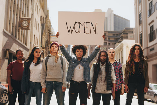 Group of women marching on the road in protest